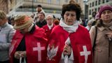 WARSAW, MAZOWIECKIE, POLAND - 2019/10/05: Women dressed in a crucifix cape with the Polish emblem are seen praying during the march.The National Rosary March took place in Warsaw with over 500 believers from all over Poland participated. The march is orga